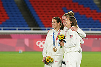 YOKOHAMA, JAPAN - AUGUST 6: Kelley O'Hara #5 of the United States, Goalkeeper Alyssa Naeher #1 of the United States and Tobin Heath #7 of the United States pose for a picture during the ceremony at International Stadium Yokohama on August 6, 2021 in Yokohama, Japan.