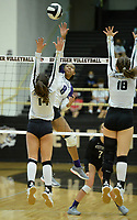 Fayetteville's Rosana Hicks (8) sends the ball over the net Tuesday, Sept. 15, 2020, as Bentonville's London McKinney (14) and Bella Engledow (18) defend during play in Tiger Arena in Bentonville. Visit nwaonline.com/200916Daily/ for today's photo gallery. <br /> (NWA Democrat-Gazette/Andy Shupe)