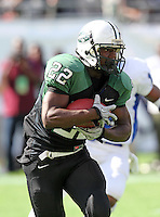 Miami Central Rockets running back Joseph Yearby #22 runs upfield during the first quarter of the Florida High School Athletic Association 6A Championship Game at Florida's Citrus Bowl on December 17, 2011 in Orlando, Florida.  The score at halftime is Armwood 16 - Miami Central 14.  (Mike Janes/Four Seam Images)