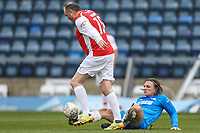 Nev Wilshire is tackled by Gareth Ainsworth during the Celebrity football match in aid of the charity's 'Keep Moving Forward' programme which benefits people with mental health issues put together by Wycombe Wanderers Sports & Education Trust and Sellebrity Soccer Football Match at Adams Park, High Wycombe, England on 7 April 2019. Photo by David Horn.