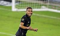 CARSON, CA - OCTOBER 28: Eddie Segura #4 of the Los Angeles FC scores a goal and celebrates and smiles for the camera during a game between Houston Dynamo and Los Angeles FC at Banc of California Stadium on October 28, 2020 in Carson, California.