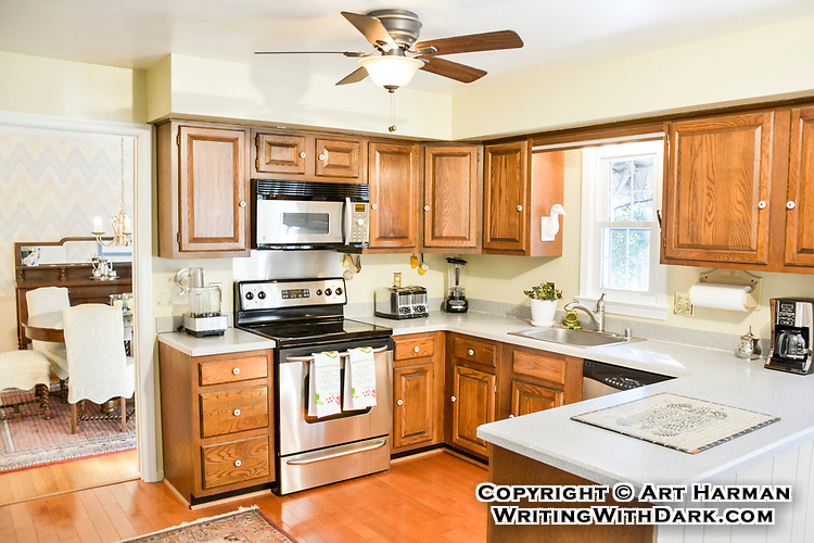 Kitchens sell a home, and a bit of care in setting up lighting and making sure everything looks neat and un-cluttered makes a big difference.