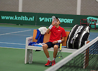 Rotterdam, The Netherlands, 15.03.2014. NOJK 14 and 18 years ,National Indoor Juniors Championships of 2014, Amadatus Admiraal (NED) at changeover<br /> Photo:Tennisimages/Henk Koster