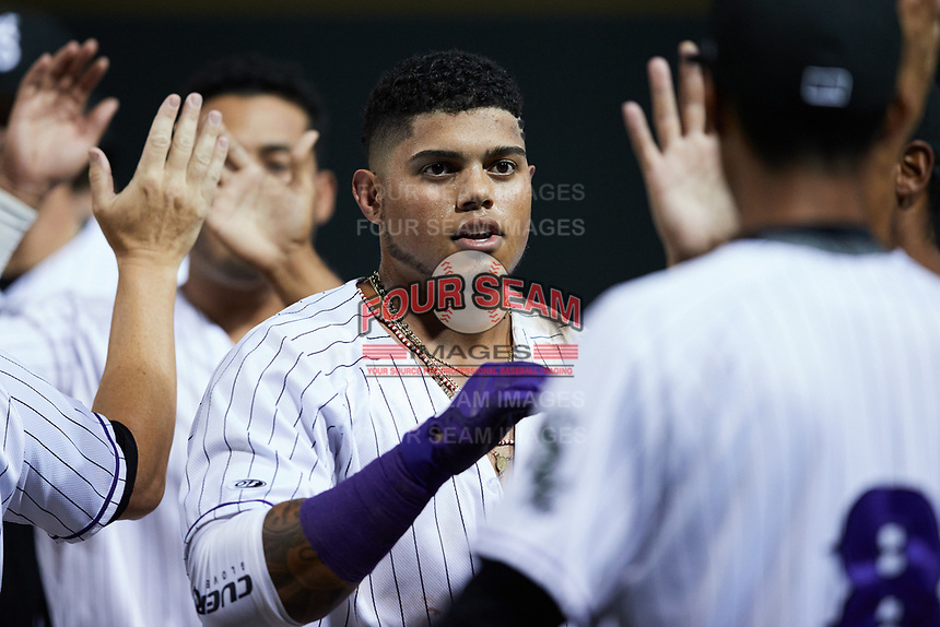 Harvin Mendoza (17) of the Winston-Salem Dash celebrates following his walk-off single against the Bowling Green Hot Rods at Truist Stadium on September 7, 2021 in Winston-Salem, North Carolina. (Brian Westerholt/Four Seam Images)