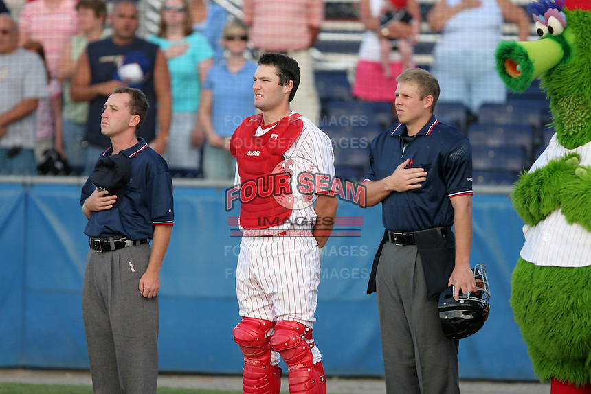 Umpire Keith Rogowski, Batavia Muckdogs catcher Joel Naughton, umpire Tripp Gibson and the Phillie Phanatic during the national anthem before a NY-Penn League game at Dwyer Stadium on August 4, 2006 in Batavia, New York.  (Mike Janes/Four Seam Images)