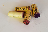 Corks: Corbieres, Fitou, 2004. Chateau des Erles. In Villeneuve-les-Corbieres. Fitou. Languedoc. Handful of corks on a table. France. Europe.