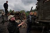Mizhgirya, Ukraine.June 8, 2005 ..Wood cutters in the mountains....