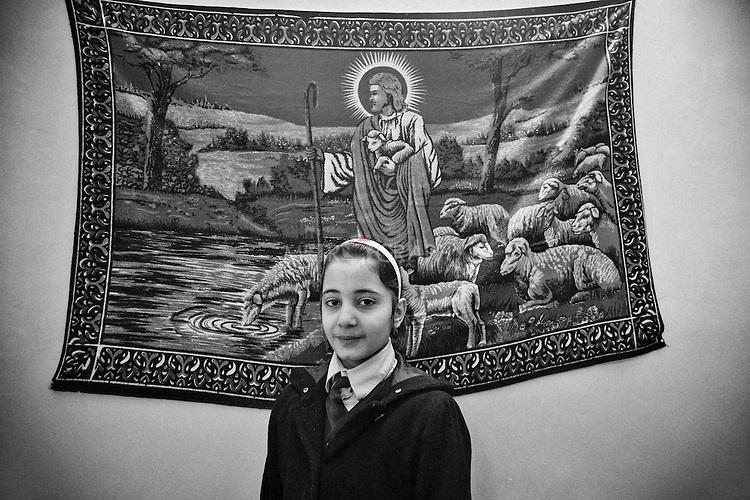 29.1.2015 Kirkuk , Iraq. Marta Ghanim, 11 years old, in her school dress. She studies in a Christian School.