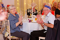 Pictured: Guests applaud the Rat Pack act. Wednesday 28 November 2018<br /> Re: National Lottery millionaires from south Wales and the south west of England have hosted a glitzy Rat Pack-inspired Christmas party for an older people's music group at The Bear Hotel in Cowbridge, Wales, UK.