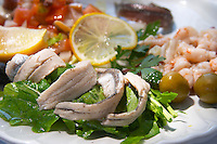 A salad dish with marinated anchovies and other seafood. Hotel and restaurant Kompas. Uvala Sumartin bay between Babin Kuk and Lapad peninsulas. Dubrovnik, new city. Dalmatian Coast, Croatia, Europe.