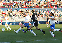 Sonia Bompastor #8 of the Washington Freedom slips a pass past Amy LePelbet #6 of the Boston Breakers during a WPS match at the Maryland Soccerplex, in Boyd's, Maryland, on April 18 2009. Breakers won the match 3-1.