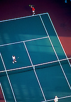 People playing at a tennis court