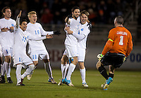 Jordan Gafa (14) of North Carolina celebrates with teammates Alex Walters (34), Scott Goodwin (1), Danny Garcia (17) and Verneri Valimaa (18) after the game at the Maryland SoccerPlex in Germantown, MD. North Carolina defeated Virginia on penalty kicks after playing to a 0-0 tie in regulation time.  With the win the Tarheels advanced to the finals of the ACC men's soccer tournament.
