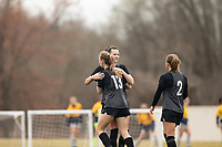 LOUISVILLE, KY - MARCH 13: Cece Kizer #5 and Emina Ekic #13 of Racing Louisville FC hug after a goal during a game between West Virginia University and Racing Louisville FC at Thurman Hutchins Park on March 13, 2021 in Louisville, Kentucky.