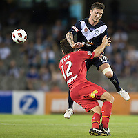 MELBOURNE, AUSTRALIA - OCTOBER 30: Paul Reid of United and Billy Celeski of the Victory compete for the ball during the round 12 A-League match between the Melbourne Victory and Adelaide United at Etihad Stadium on October 30, 2010 in Melbourne, Australia.  (Photo by Sydney Low / Asterisk Images)
