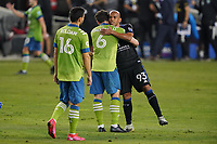 SAN JOSE, CA - OCTOBER 18: Joao Paulo #6 of the Seattle Sounders hugs Judson #93 of the San Jose Earthquakes during a game between Seattle Sounders FC and San Jose Earthquakes at Earthquakes Stadium on October 18, 2020 in San Jose, California.