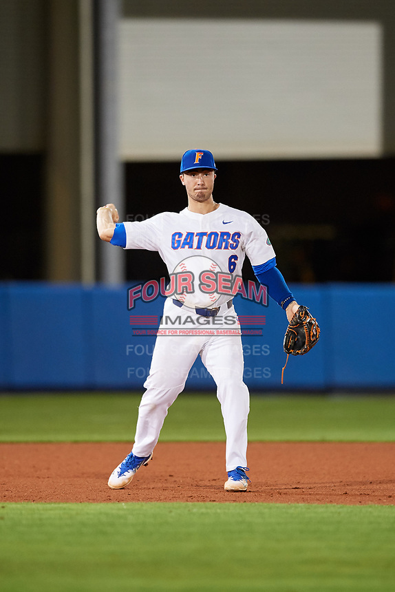 Florida Gators third baseman Jonathan India (6) throws to first base during a game against the Siena Saints on February 16, 2018 at Alfred A. McKethan Stadium in Gainesville, Florida.  Florida defeated Siena 7-1.  (Mike Janes/Four Seam Images)