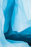 Shapes, colours and textures of blue glacial ice of ice cave on Franz Josef Glacier, Westland Tai Poutini National Park, West Coast, UNESCO World Heritage Area, New Zealand, NZ