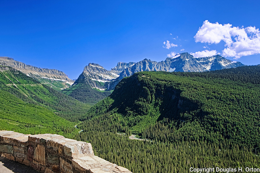Bird Woman Falls is seen from the Grand Loop viewpoint along Going-to-the-Sun Road, Glacier National Park is fifty miles of hair raising driving and stunning views.  Completed in 1933, it winds to Logan Pass from Lake McDonald, sometimes cut through solid granite cliffs.