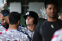 Mitch Roman (10) of the Kannapolis Intimidators high fives teammates in the dugout after hitting a solo home run against the Delmarva Shorebirds at Kannapolis Intimidators Stadium on June 30, 2017 in Kannapolis, North Carolina.  The Shorebirds defeated the Intimidators 6-4.  (Brian Westerholt/Four Seam Images)