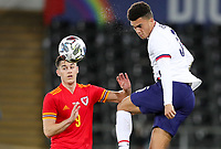 SWANSEA, WALES - NOVEMBER 12: Antonee Robinson #5 of the United States  heads a ball during a game between Wales and USMNT at Liberty Stadium on November 12, 2020 in Swansea, Wales.
