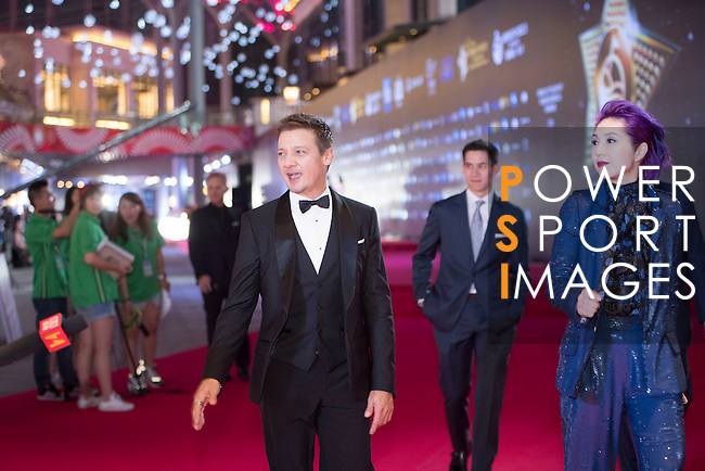 Jeremy Renner and Miriam Yeung walk the Red Carpet event at the World Celebrity Pro-Am 2016 Mission Hills China Golf Tournament on 20 October 2016, in Haikou, China. Photo by Weixiang Lim / Power Sport Images