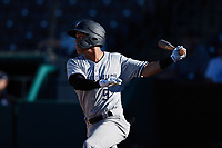 Eduardo Torrealba (9) of the Hudson Valley Renegades follows through on his swing against the Greensboro Grasshoppers at First National Bank Field on September 2, 2021 in Greensboro, North Carolina. (Brian Westerholt/Four Seam Images)
