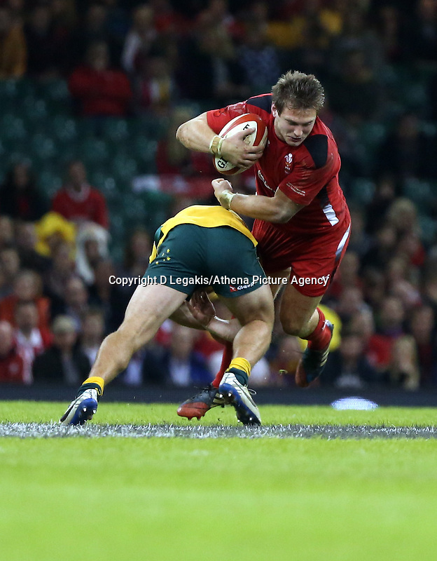 Pictured: Dan Biggar of Wales (L) is brought down by an Australia player Saturday 08 November 2014<br /> Re: Dove Men Series rugby, Wales v Australia at the Millennium Stadium, Cardiff, south Wales, UK.