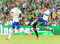 AUSTIN, TX - JUNE 19: Nick Lima #24 of Austin FC and Eric Remedi #5 of the SJ Earthquakes battle for control of a loose ball during a game between San Jose Earthquakes and Austin FC at Q2 Stadium on June 19, 2021 in Austin, Texas.