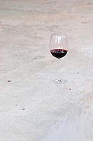 A glass of Sivric wine outside the winery. Podrum Vinoteka Sivric winery, Citluk, near Mostar. Federation Bosne i Hercegovine. Bosnia Herzegovina, Europe.