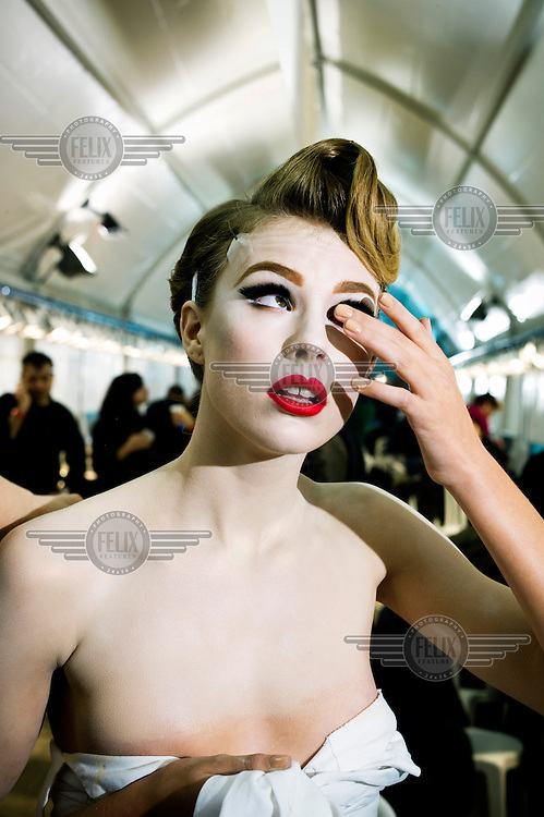 A model backstage at the DIOR fashion show during Paris Fashion Week.