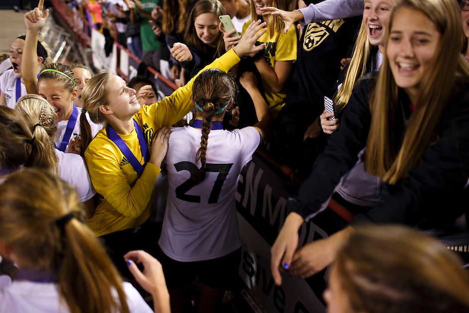 Penn keeper Sommer Domal, left, reaches out to a fan in the crowd after a 2-0 win against Brebeuf Jesuit in the IHSAA Class 2A Girls Soccer State Championship Game on Saturday, Oct. 29, 2016, at Carroll Stadium in Indianapolis. Special to the Tribune/JAMES BROSHER