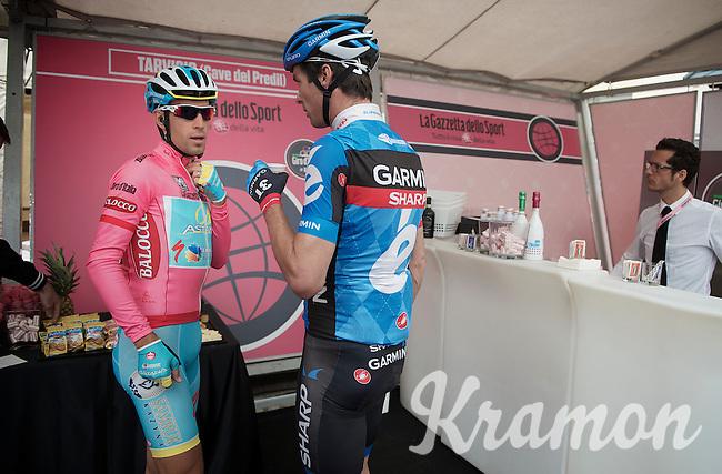 2013 Giro d'Italia.stage 11.Tarvisio - Vajont: 182km..Vincenzo Nibali (ITA) & David Millar (GBR) going for a coffee in the Gazetta Cafe before the start..