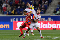 Harrison, NJ - Thursday March 01, 2018: Diego Reyes, Aaron Long. The New York Red Bulls defeated C.D. Olimpia 2-0 (3-1 on aggregate) during a 2018 CONCACAF Champions League Round of 16 match at Red Bull Arena.