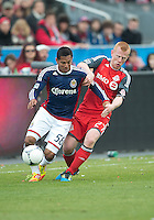 14 April 2012: Chivas USA forward Cesar Romero #58 and Toronto FC defender Richard Eckersley #27 in action during a game between Chivas USA and Toronto FC at BMO Field in Toronto..Chivas USA won 1-0.