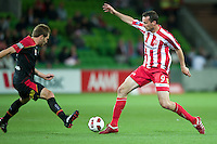 MELBOURNE, AUSTRALIA - NOVEMBER 19: Gerald Sibon of the Heart and Adam Hughes of Adelaide in action during the round 15 A-League match between the Melbourne Heart and Adelaide United at AAMI Park on November 19, 2010 in Melbourne, Australia (Photo by Sydney Low / Asterisk Images)