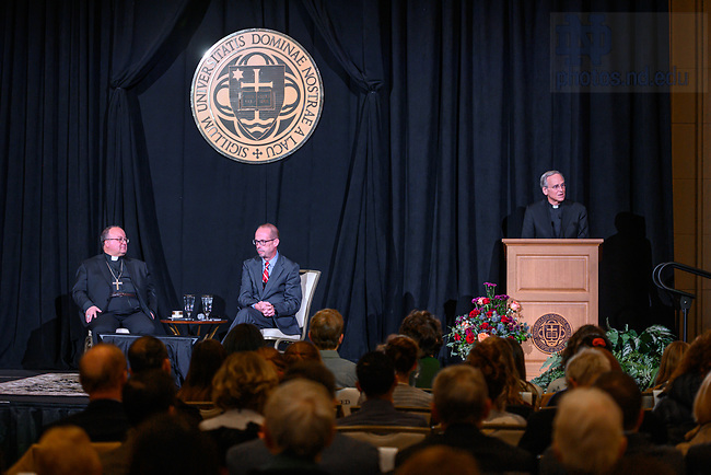 """November 13, 2019; University of Notre Dame President Rev. John I. Jenkins, C.S.C., right, introduces Malta Archbishop Charles Scicluna, adjunct secretary of the Vatican's Congregation for the Doctrine of the Faith, left, and moderator John Allen, editor-in-chief of Crux, center, before a discussion on the sexual abuse crisis in the Catholic Church, part of the 2019-20 Notre Dame Forum: """"Rebuild My Church: Crisis and Response."""" Archbishop Scicluna spoke and took questions from Notre Dame students audience members and online participants. (Photo by Matt Cashore/University of Notre Dame)"""