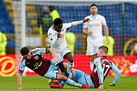Nathan Dyer of Swansea City is tackled by Robbie Brady and Johann Gudmundsson of Burnley during the Premier League match between Burnley and Swansea City at Turf Moor, Burnley, England, UK. Saturday 18 November 2017