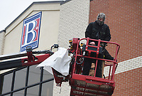 """Sign installers Austin Yates (foreground) and Nate Frihart finish installing a sign, Thursday, February 11, 2021 at the Bentonville Administrative Services building in Bentonville. A crew from Arkansas Sign and Banner installed the big """"B"""" on the City of Bentonville Administrative Services building. Check out nwaonline.com/210212Daily/ for today's photo gallery. <br /> (NWA Democrat-Gazette/Charlie Kaijo)"""