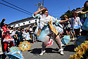 Alana Harris, founder of the Creole Belle Baby Dolls, dances in Treme on Mardi Gras Day, 2018