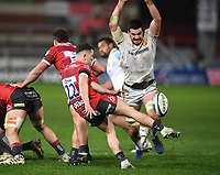 26th March 2021; Kingsholm Stadium, Gloucester, Gloucestershire, England; English Premiership Rugby, Gloucester versus Exeter Chiefs; Charlie Chapman of Gloucester kicks under pressure from Tom Price of Exeter Chiefs