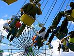 Fair goers ride the swings at the Western Washington State Fair.