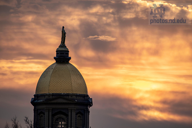 April 3, 2020; Main building at sunrise . (Photo by Barbara Johnston/University of Notre Dame)
