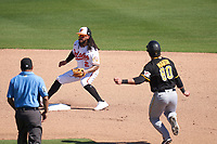 Baltimore Orioles shortstop Freddy Galvis (2) waits for a throw as Mason Martin (80) slides into second base during a Major League Spring Training game against the Pittsburgh Pirates on February 28, 2021 at Ed Smith Stadium in Sarasota, Florida.  (Mike Janes/Four Seam Images)