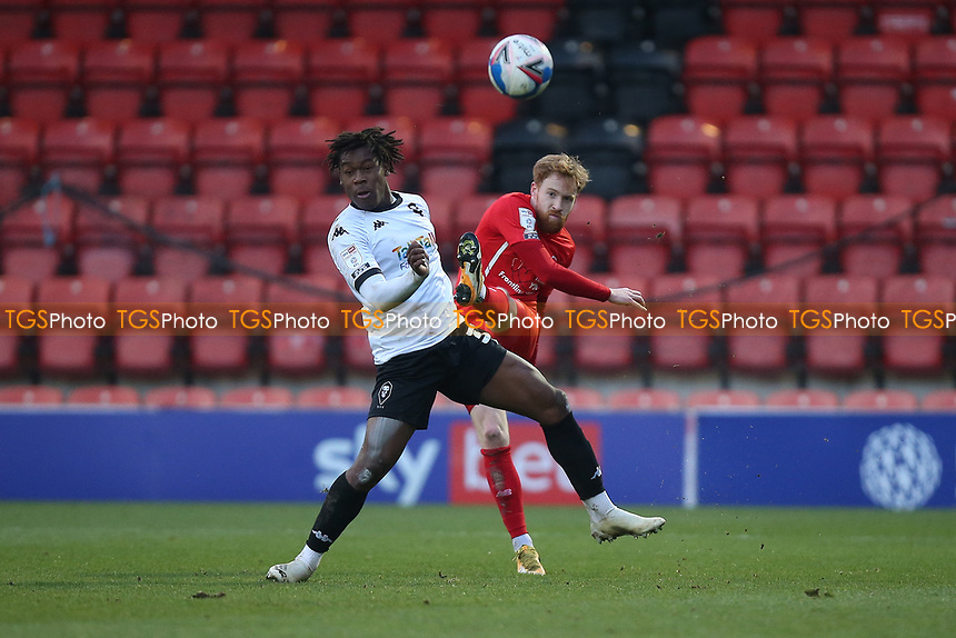James Brophy of Leyton Orient and Brandon Thomas-Asante of Salford City during Leyton Orient vs Salford City, Sky Bet EFL League 2 Football at The Breyer Group Stadium on 2nd January 2021