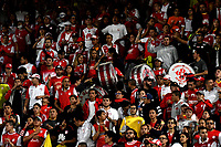 BOGOTA - COLOMBIA - 01 - 03 - 2018: Hinchas de Independiente Santa Fe, animan a su equipo durante partido entre Independiente Santa Fe (COL) y Emelec (ECU), de la fase de grupos, grupo 4, fecha 1 de la Copa Conmebol Libertadores 2018, jugado en el estadio Nemesio Camacho El Campin de la ciudad de Bogota. / Fans of Independiente Santa Fe, cheer for their team during a match between Independiente Santa Fe (COL) and Emelec (ECU), of the group stage, group 4, 1st date for the Conmebol Copa Libertadores 2018 at the Nemesio Camacho El Campin Stadium in Bogota city. Photo: VizzorImage  / Luis Ramirez / Staff.