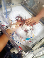 "COPY BY TOM BEDFORD<br /> Pictured: The premature baby of Luc Protheroe and partner Paighton Waters at the Royal Gwent Hospital in Newport, Wales, UK <br /> Re: A young couple were granted their Christmas wish to cwtch their ""miracle"" baby for the first time.<br /> Little Flynn Protheroe was the same size as a mobile phone when he was born 14 weeks early.<br /> The tiny baby and his mother Paighton Waters, 19, were both given a 50-50 chance of surviving after a rare placental abruption.<br /> Flynn was born by Caesarian and doctors worked on him for 20 minutes to get his tiny heart and lungs working.<br /> Meanwhile Paighton was on the critical list after losing four litres of blood.<br /> But five weeks later the pair are doing well and have been allowed to hold their little boy for a Christmas cuddle.<br /> Proud dad Luc Protheroe, 21, said: ""It's a miracle, I could have lost them both."
