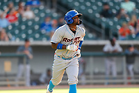 Rocket City Trash Pandas second baseman Luis Aviles Jr. (14) hustles to first base against the Tennessee Smokies at Smokies Stadium on July 2, 2021, in Kodak, Tennessee. (Danny Parker/Four Seam Images)