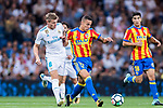 Rodrigo Moreno (r) of Valencia CF is tackled by Toni Kroos of Real Madrid during their La Liga 2017-18 match between Real Madrid and Valencia CF at the Estadio Santiago Bernabeu on 27 August 2017 in Madrid, Spain. Photo by Diego Gonzalez / Power Sport Images