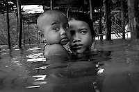 "The Moken are a nomadic tribe who live on the Surin Islands islands 60 km off the coast of Thailand. Recent scientific studies have shown that the underwater eyesight of Moken children is more than50% percent better than the underwater eyesight of other children. Scientists believe that the Moken train their eyes to see better out of necessity, they have to hunt for fish, and also make out things on the sea bed far below them. Experiments are now underway in Sweden to see if other children can train their eyes in a similar way. The Moken spend a large part of their time in the sea, and seem almost as at home in that environment as on land. At present they have no Family names or citizensip, but the Thai authorities have proposed that they all be given the same second name, roughly translated it means ""Hero of the Sea"". The entire Moken population of the Surin Islands survived the recent Tsunami. News reports say that by the time the waves crashed ashore, the Moken were already on the higher ground and therefore safe. According to interviews they relied on the sayings of their ancestors which have been passed down through generations (they have no written language) which warn of the sea disappearing and then returning with a terrible force."
